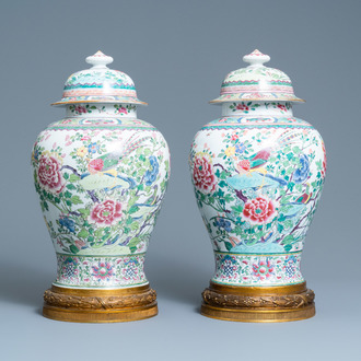 A pair of tall gilt bronze-mounted famille rose-style baluster vases and covers, Samson, Paris, 19th C.