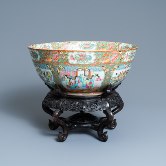 A large Chinese Canton famille rose bowl on wooden stand, 19th C.