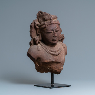 A fine red sandstone bust of a celestial nymph, Central India, 10/11th C.
