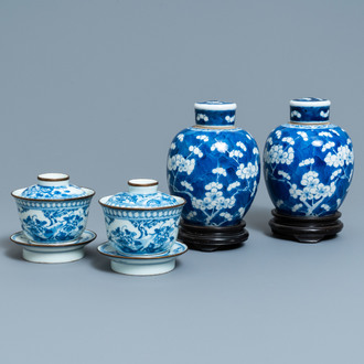 A pair of Chinese blue and white covered bowls on stands and a pair of covered jars, 19th C.