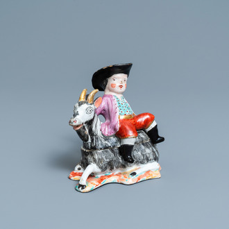 A polychrome Dutch Delft box and cover in the shape of a boy on a goat, 18th C.