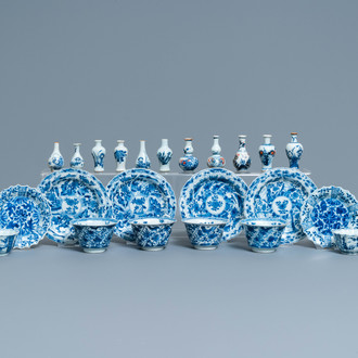 Six Chinese blue and white cups and saucers and eleven miniature vases, Kangxi