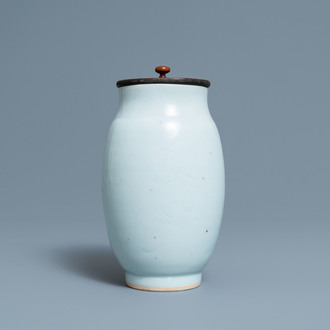 A Chinese monochrome white vase with an incised design of birds, Transitional period