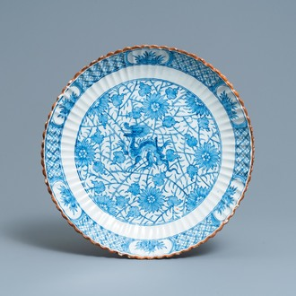 A ribbed Dutch Delft blue and white chinoiserie 'dragon' dish, 18th C.