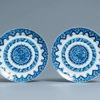 A pair of Dutch Delft blue and white dishes, dated 1713