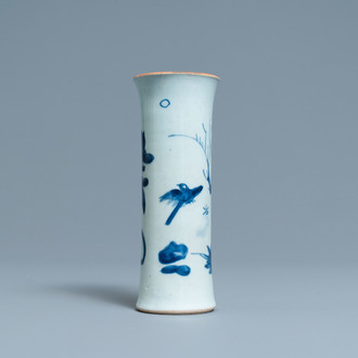 A Chinese blue and white sleeve vase with birds among blossoming branches, Transitional period