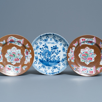 A pair of Chinese famille rose plates, Qianlong, and a blue and white plate, Kangxi mark and of the period