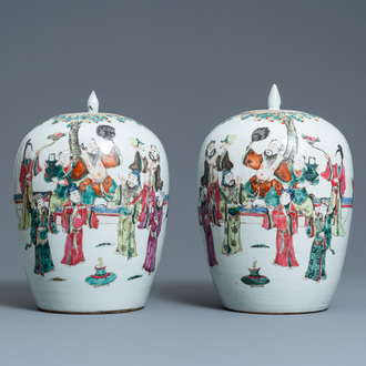 A pair of Chinese famille rose jars and covers, 19th C.