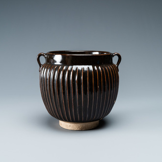 A Chinese black-glazed ribbed two-handled jar, Northern Song or Jin