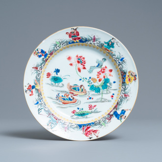 A Chinese famille rose plate with mandarin ducks in a lotus pond and immortals, Yongzheng