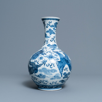 A Chinese blue and white 'dragon and phoenix' vase, Qianlong mark, 19/20th C.