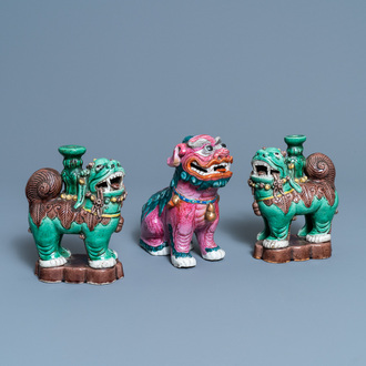 A Chinese famille rose model of a Buddhist lion and a pair of verte biscuit joss stick holders, 19th C.