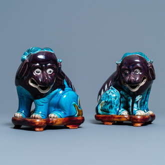A pair of Chinese turquoise- and aubergine-glazed models of mythical animals, 19th C.