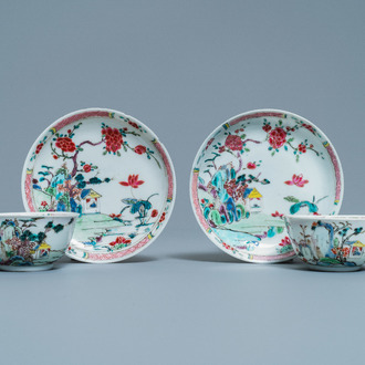 A pair of Chinese famille rose cups and saucers with landscape design, Yongzheng