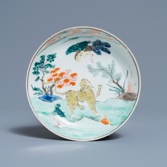 A Chinese famille verte 'tiger and phoenix' saucer, 19th C.