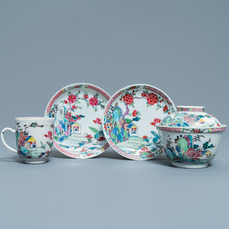 A Chinese famille rose covered bowl, a cup and two saucers with landscape design, Yongzheng