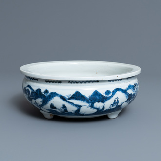 A Chinese blue and white tripod censer with figures in a mountainous landscape, Kangxi