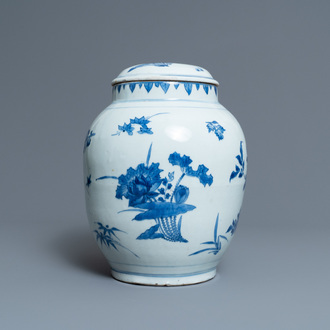A Chinese blue and white jar and cover with floral sprigs, Transitional period