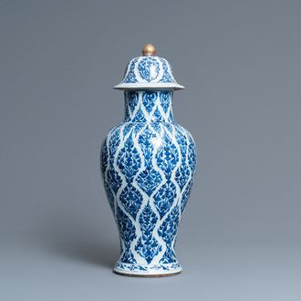 A Chinese blue and white vase and cover, Kangxi
