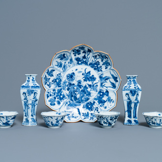 A pair of Chinese blue and white vases, a 'lotus' dish and four cups, Kangxi