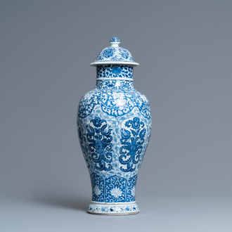 A Chinese blue and white vase and cover with floral design, Kangxi