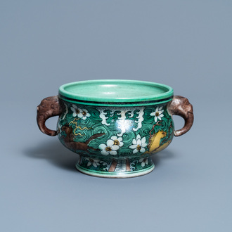 A Chinese verte biscuit 'flaming horses' censer, Jiajing mark, 18/19th C.