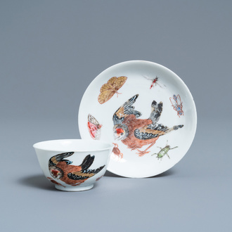 A Chinese famille rose cup and saucer with a bird and insects, Yongzheng