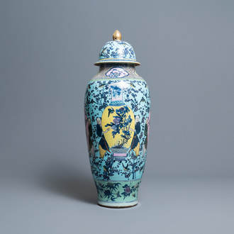 A very large Chinese famille rose turquoise-ground vase and cover, 19th C.