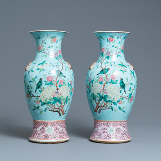 A pair of Chinese famille rose turquoise-ground vases with butterfly handles, 19th C.