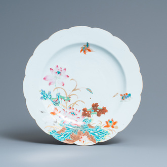 A Chinese famille rose dish with mandarin ducks near a lotus pond, Qianlong