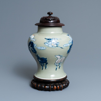 A Chinese blue, white and copper-red celadon-ground vase birds and deer, Kangxi