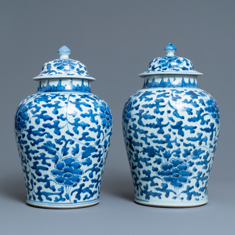 A pair of Chinese blue and white 'peony scroll' vases and covers, Kangxi