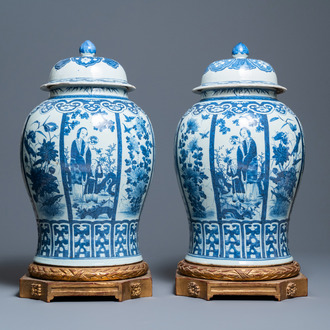 A pair of large Chinese blue and white covered vases, 19th C.