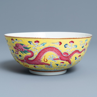A Chinese yellow-ground famille rose 'dragon and phoenix' bowl, Xuantong mark and of the period