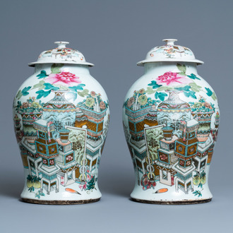 A pair of Chinese qianjiang cai vases and covers with antiquities, 19/20th C.