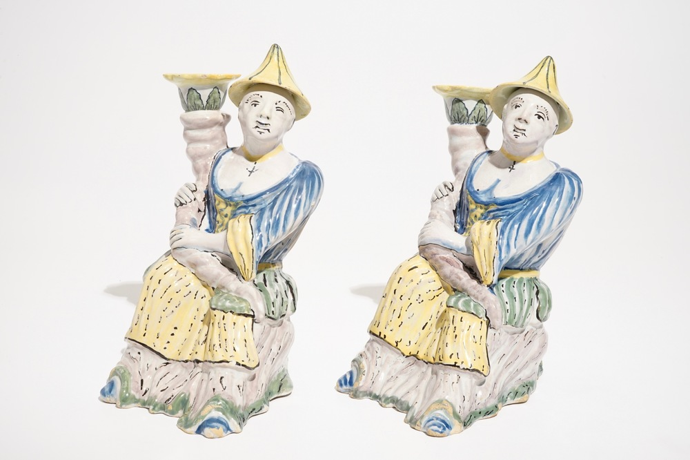 A pair of polychrome Brussels faience candlesticks modelled as chinamen, ca. 1800