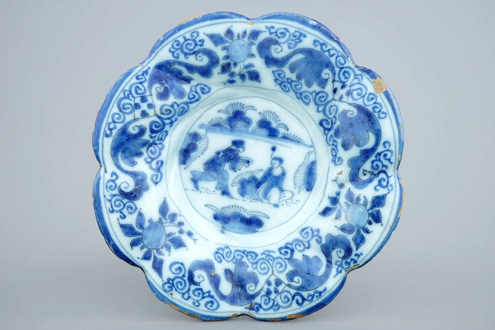 A Dutch Delft blue and white gadrooned chinoiserie dish, 2nd half 17th C.