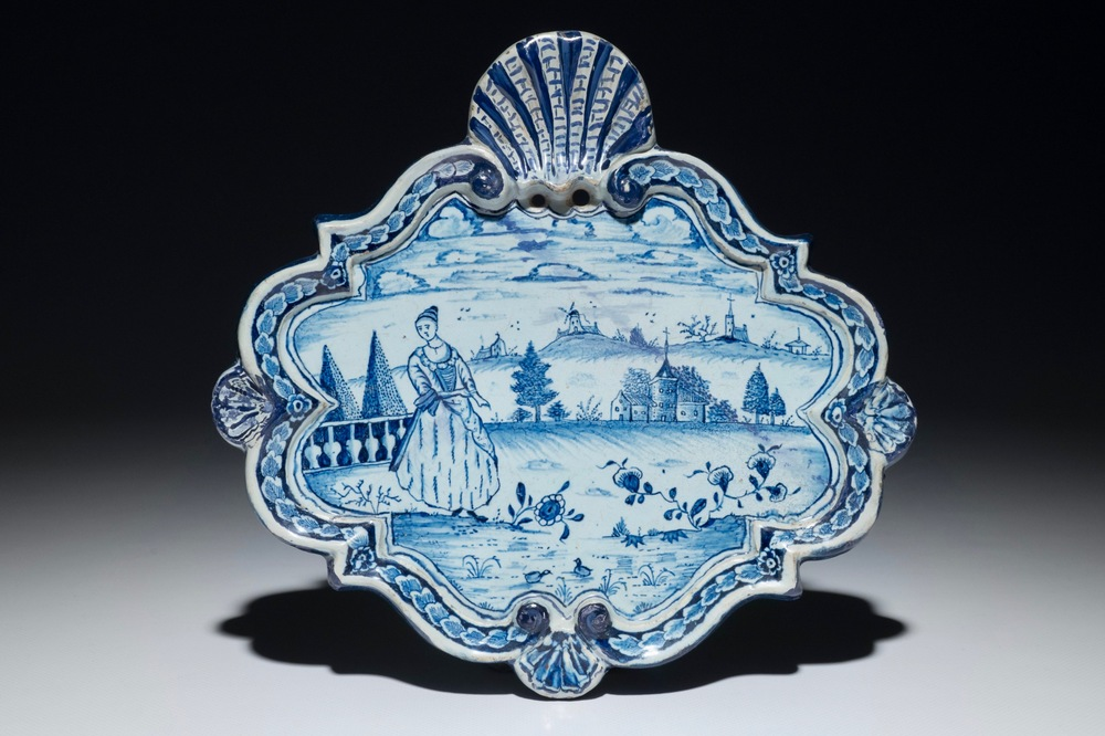 A Dutch Delft blue and white plaque with a lady in a landscape, 18th C.