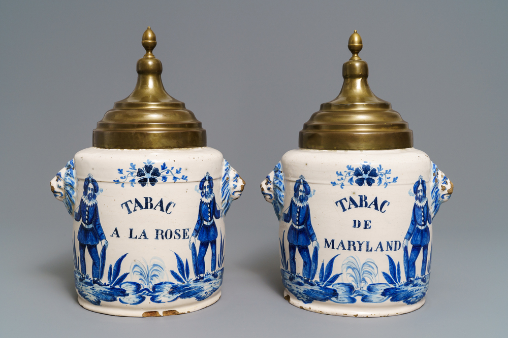 A pair of blue and white Brussels faience tobacco jars, late 18th C.