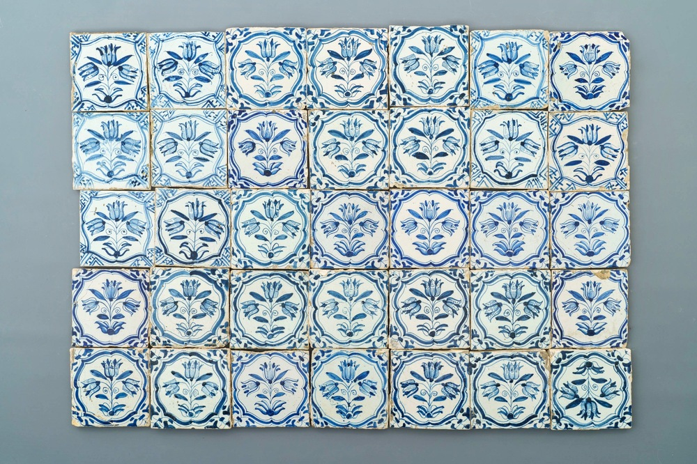 Thirty-five Dutch Delft blue and white 'three-tulip' tiles, 17th C.