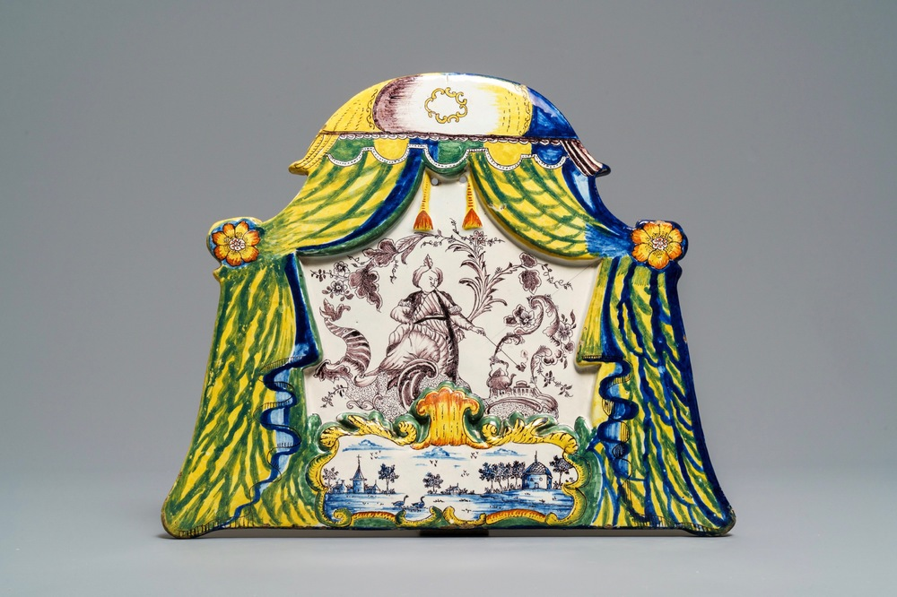 A large polychrome Dutch Delft plaque with a smoking Turk, 18th C.