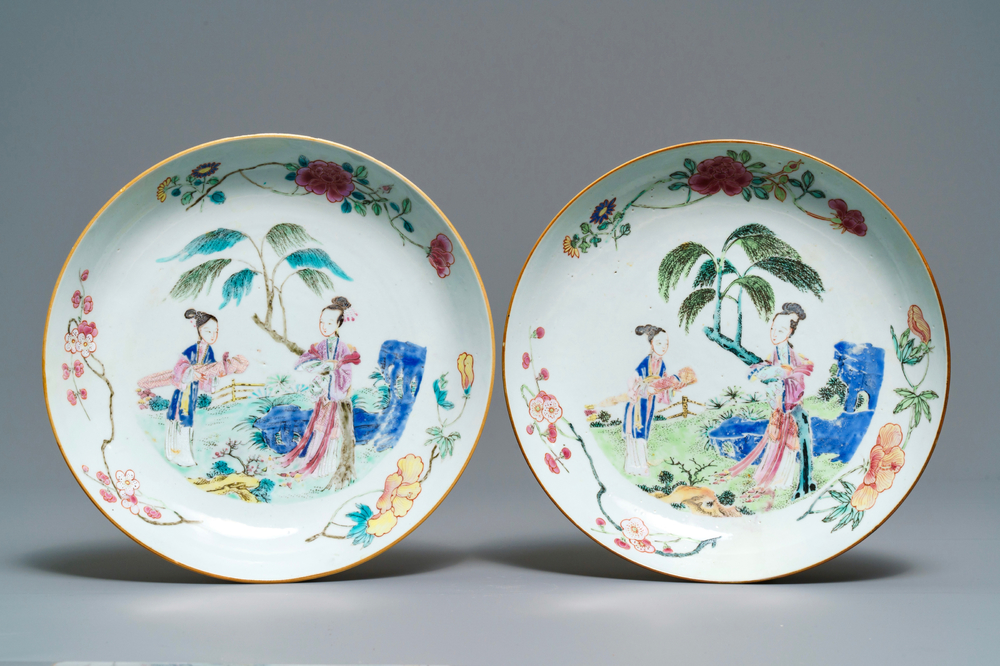 A pair of Chinese famille rose plates with ladies in a garden, Yongzheng/Qianlong