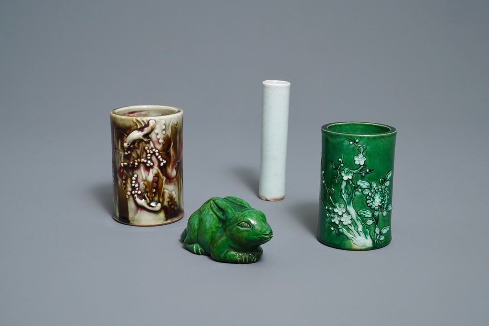 Two Chinese monochrome relief-decorated brush pots, an incense tube and a rabbit, 18/19th C.