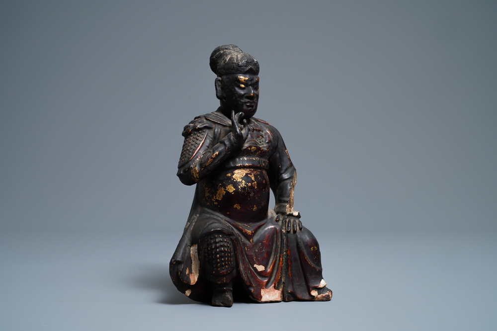 A Chinese gilt-lacquered wood figure of Guan Yu, Ming