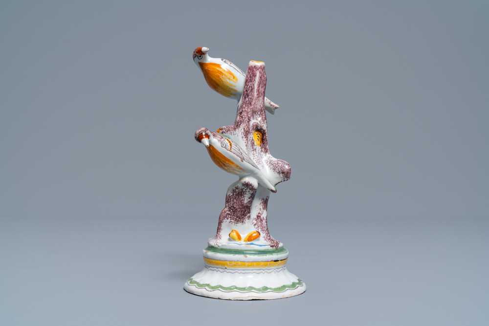 A polychrome Brussels faience group of a tree with birds, 18th C.