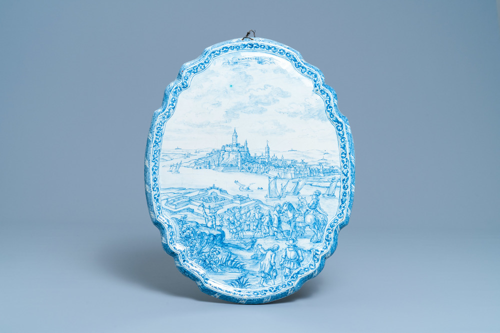A large Dutch Delft blue and white plaque with a view on the city of Nijmegen, 18th C.