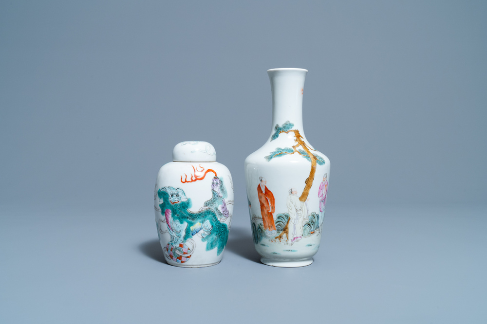 A Chinese famille rose vase and a covered jar with Buddhist lions, 19/20th C.