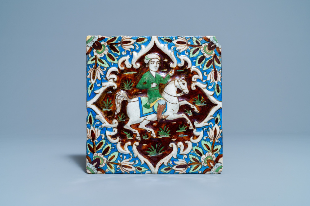 A polychrome 'prince on horseback' relief-moulded tile, Qajar, Iran, 19th C.