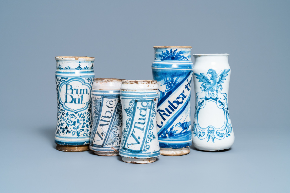 A collection of five Spanish blue and white albarello-type drug jars, 17th C.