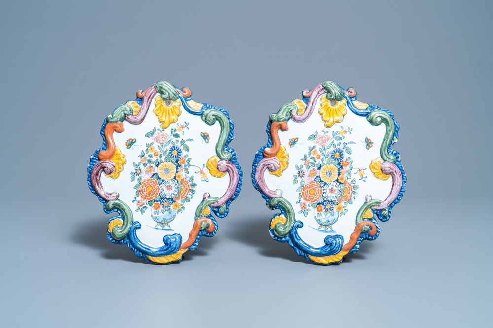 A pair of fine polychrome Dutch Delft plaques with still lifes of flowers in a vase, 18th C.